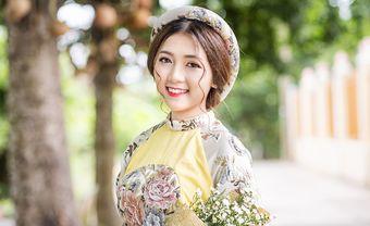 Giúp cô dâu mặt tròn biến hóa đa phong cách với chiếc áo dài cưới - Blog Marry