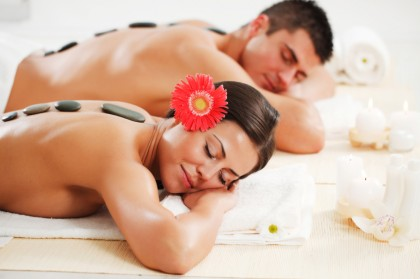 Young couple receiving a hot stone therapy.
