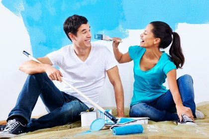 bigstock-cute-couple-painting-new-home-47325577